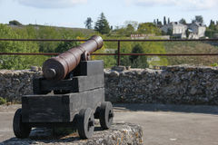 Old cannon at the fortress . Chinon. France. A picturesque old cannon on the bastions of the fortress. Chinon. France Royalty Free Stock Images