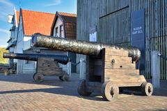 Old cannon in front of sea archaeology Museum `Kaap Skil` on island Texel