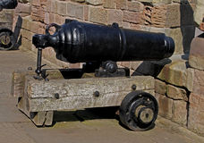 Old Cannon looking over beach, Northumberland. Royalty Free Stock Photo