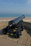 Old Cannon looking over beach, Northumberland. Stock Photo