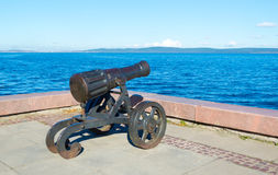 Old cannon in Petrozavodsk Karelia, Russia. Ancient cannon created at the Alexander factory. Located on the waterfront of Lake Onega in Petrozavodsk. It weaved Royalty Free Stock Photo