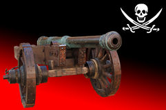 Old cannon  (pirat flag). Cannon in front of a pirate flag Stock Photography