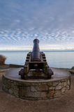 Old cannon. Pointing to sea royalty free stock images