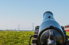 Old cannon pointing towards the Great Belt Bridge. In town of Korsoer in Denmark royalty free stock images