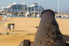 Old cannon on the promenade near the harbor in Palamos Stock Photography