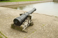 Old cannon on the shore. Stock Image