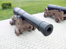 The old cannon, stands in the walking park. Old cannon on gun carriage, standing in a walking Park Stock Photo