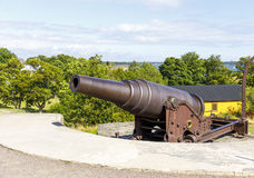 Cannon in Suomenlinna fortress area in Helsinki. Old cannon in Suomenlinna fortress area in Helsinki, Finland Royalty Free Stock Photography