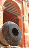 Old cannon tip with old building Stock Image