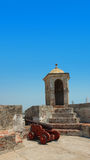 Old cannon and tower in Castillo San Felipe de Barajas Royalty Free Stock Photo