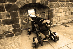Old cannon in wall in Edinburgh castle Stock Images