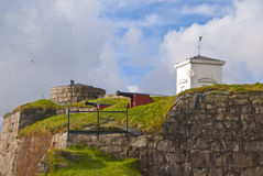 Old cannons. Locaded in, Over the King's Bastion at Fredriksten fortress in Halden, Norway. Left behind are Fire leader tower, and behind the right is the bell Stock Photos
