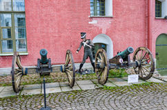 The old cannons and the cannoneer mannnequin in the Inner yard. Royalty Free Stock Photography
