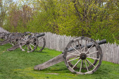 Old cannons with fortified stockade wooden defense wall. Baturyn town in Ukraine Royalty Free Stock Image