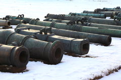 Old cannons on snow stock photography