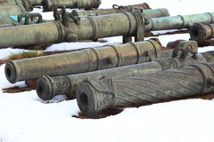 Old cannons on snow closeup royalty free stock photo