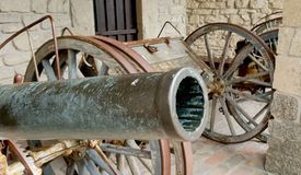 Old cannons to defense the castle. Old cannons ready to defense from the internal wall of the italian castles stock image