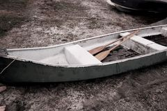 Vintage Canoe. Canoe sitting by the lake Royalty Free Stock Photo