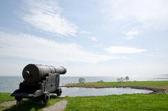 Old canon. Pointing over the sea Royalty Free Stock Image
