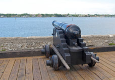 Old canon aiming at the sea Stock Images