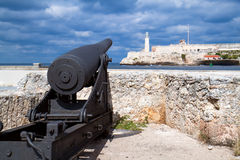Old Canon looking at castle  del Morro Stock Image