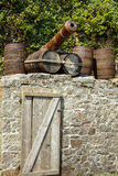 Old canons and barrels in Historic Port of Charlestown Royalty Free Stock Images