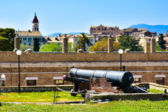 Old canons in the venetian fortress with the new Corfu Town Royalty Free Stock Images