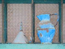 Old cans and funnels Stock Images