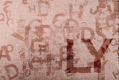 Old canvas background with letters and numbers Royalty Free Stock Image