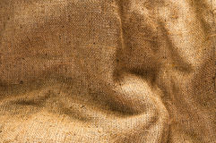 Old canvas, brown sackcloth, vintage beige fabric texture. For background Royalty Free Stock Photos
