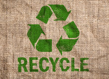 Old canvas with green recycle sign. Stock Photos