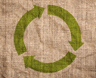 Old canvas with green recycle sign. Rough old canvas with green recycle sign Stock Photography