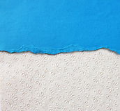 Old canvas texture background with delicate stripes pattern and blue vintage torn paper Royalty Free Stock Photo