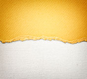 Old canvas texture background with delicate stripes pattern and orange vintage torn paper stock image