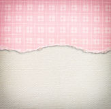 Old canvas texture background with delicate stripes pattern and pink vintage torn paper Stock Photo
