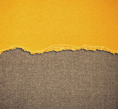 Old canvas texture background with delicate stripes pattern and yellow vintage torn paper Stock Image