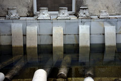 Old capitals. This is the interior of a building with old marble capitals stock photo