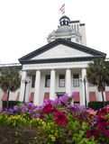 Old Capitol - Tallahassee Florida. A garden of blooming flowers and tall columns decorate the entrance to the Old Capitol of Florida in Tallahassee that was Stock Photos