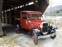 Old car. At covered wooden bridge, Vermont, USA Royalty Free Stock Images