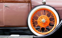 Old car. With orange tire profile Royalty Free Stock Photo