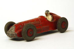 Old car. Old miniature  race car on white background Royalty Free Stock Images