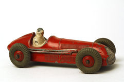 Old car. Old miniature  race car on white background Royalty Free Stock Image