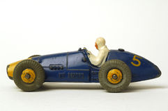 Old car. Old miniature  race car on white background Stock Photos