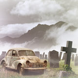 Old Car. A Misty Graveyard, Cemetery with Tombstones and an Old Vintage Car Royalty Free Stock Images