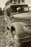Old car. Old retro 4x4 car in a village in Romania royalty free stock image