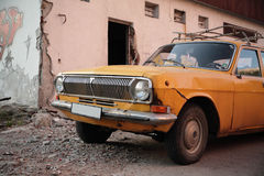 Old car. Near demolished building Stock Photo