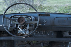 Old car abandoned, dashboard and steering wheel Royalty Free Stock Photo