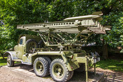 Old car adapted as a military rocket launcher standing on the sq Royalty Free Stock Photography