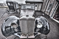 Old car and Amish buggy Royalty Free Stock Image