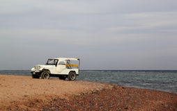 Old car on the beach Stock Photography
